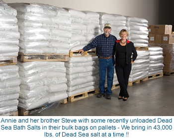 Annie and her brother Steve in front of recently unloaded Dead Sea Bath Salts in their bulk bags on pallets - We bring in 43,000 lbs. at a time !!